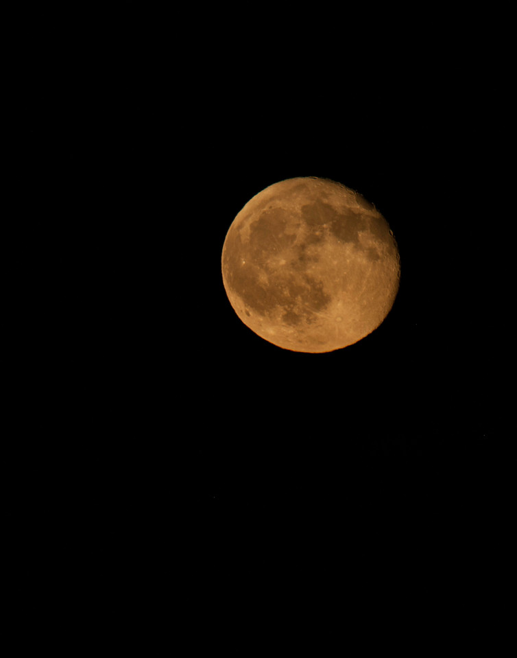 I took this photo of the moon on the way home from dropping Noah off at home.  I lamented that I did not have my tripod.