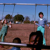 11. The swings were always popular at recess. That's Dianne Davis at left, Emily Lowery at right, and Tabitha Mills watching the camera.