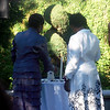 The bride and groom's Mothers light the candles