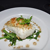 Crusted Alaskan Halibut served over a bed of spinach and greens - delicious