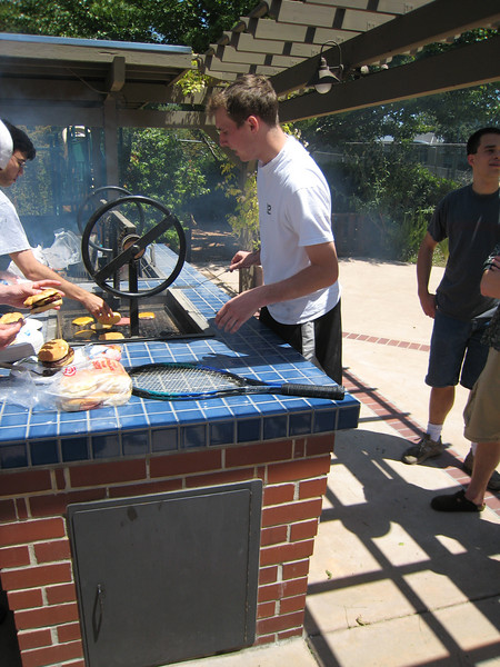 Brad Pearson fires up the grill at his sister's (Laura) birthday party.