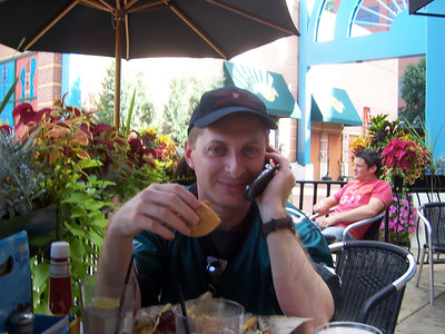 Sean having a power lunch, conference call in progress, he's calling in some of his plays to McNabb before the game.