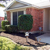 After - Front flower/shrub bed.  Isn't that much much better?  The twigs at camera right are a rose bush that needed pruning.  It will blossom next season.
