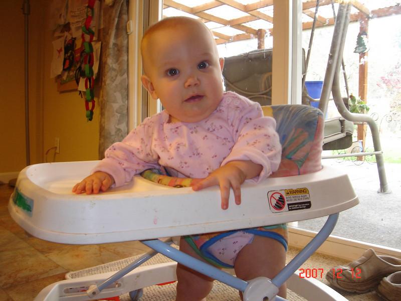 7 month old Annora burning around in her walker.