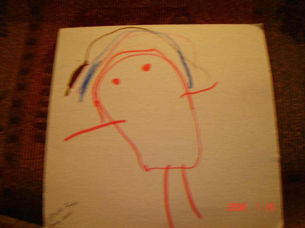 My favorite first drawing by 3 year old Elliot.  A man under a rainbow.