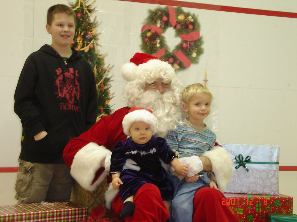 Hawthorn's breakfast with Santa.  11, 4 and 7 months.  Ian is in Oklahoma.