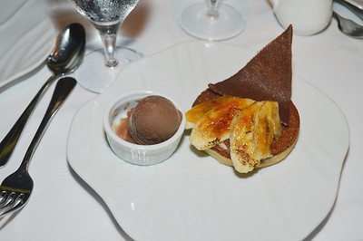 Banana cake with candied bananas and chocolate ice-cream