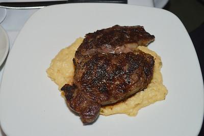 Rib eye steak with grits