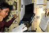 Photo of Kalpana at work during STS-107 mission.
