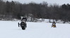 Snowmobile drivers show off on the Chippewa River.