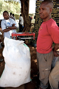 Porters getting assigned their loads at the starting point of the Lemosho trail up the Kilimanjaro. Maximum load is 20 kg per porter.