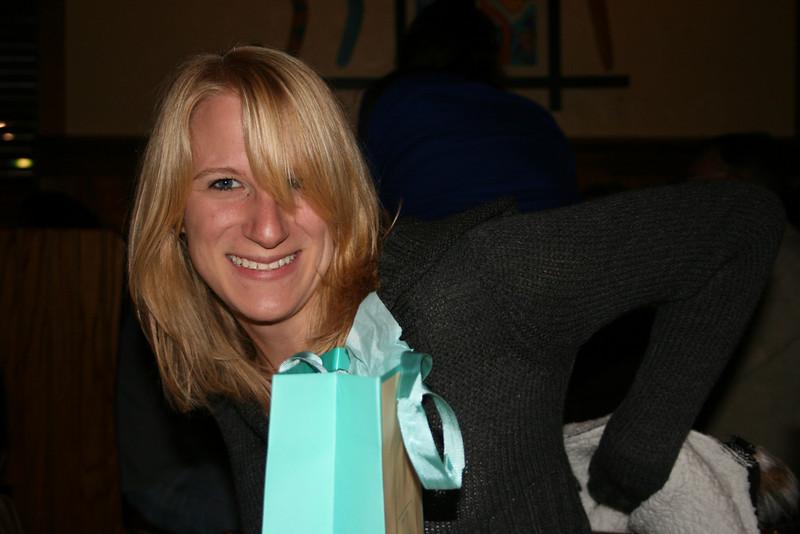 Sandy holding gift...