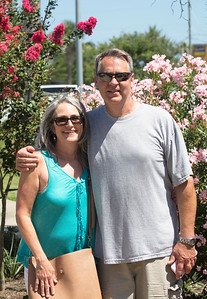 Sara and Peter by the flowery bushes at the Ferry slip
