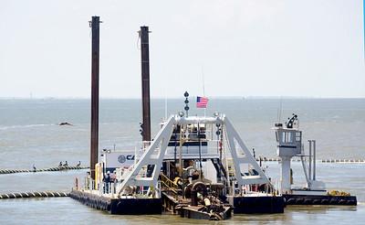 A Callan Marine dredge working near the Bolivar pier