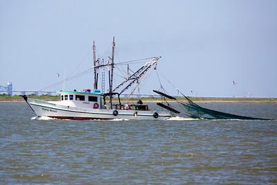 A shrimp boat dragging its nets