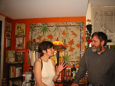 Guests talk in kitchen