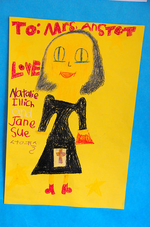 Portrait of Ms. Anstett by 2nd graders 3-10