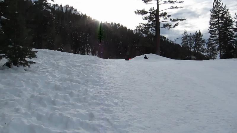 Rahul and Vihaan sledding.