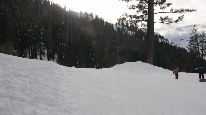 Chaitali and Vihaan sledding.