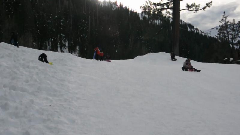 Rahul and Vihaan sledding - fast!