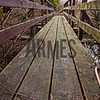 A thick film of algae now covers the bridge changing it's colour to a slimy mix of black and green, rendering it very slippery. A firm hold on the handrails is recommended for a safe passage.