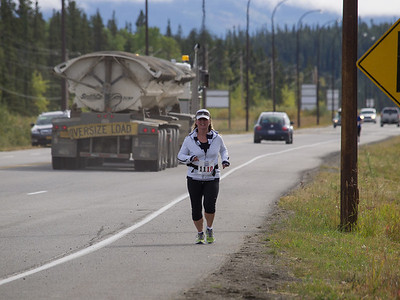 But one runner remains. Lots of runners ran through the night, but the photographer enjoyed a good sleep. Mara makes her way into Whitehorse with an impressive 8 minute pace.