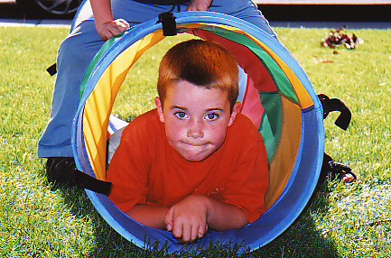 Lucas and Landon playing with the tunnel in our front yard. Summer 2005