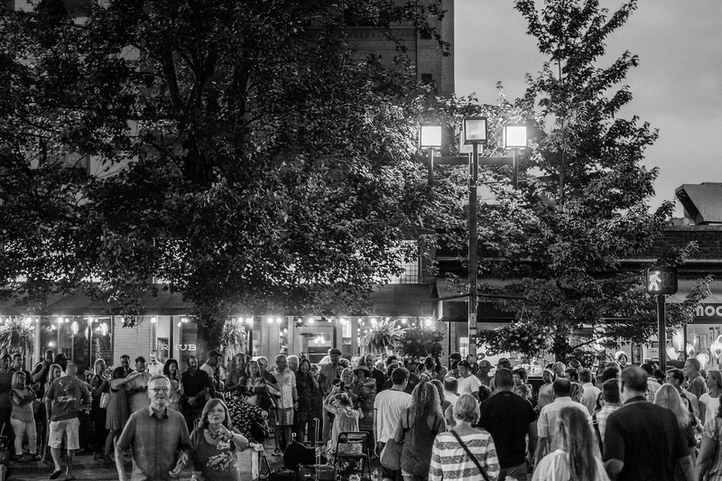 July Saturday night in downtown Asheville with busker Abbey the Spoon Lady taking center stage.
