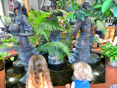 Olive & Milo watching fish at the Boulder Dushanbe Tea House.