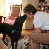 Leslee getting a face wash while petting the youngest, Apollo