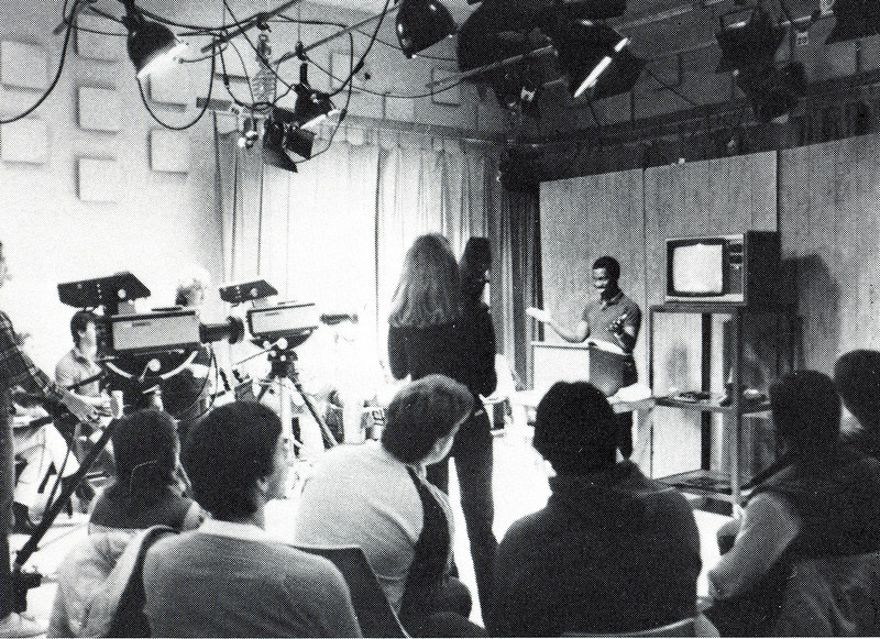 Promo photo of a TV production class with Willie Dawkins as the on air talet.