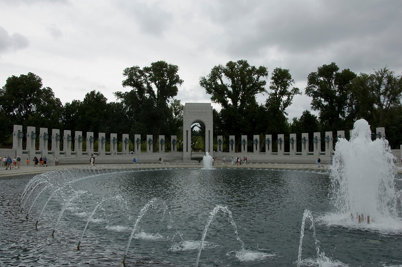 "The National World War II Memorial in Washington, D.C. was dedicated in May of 2004.<br /> <br /> The memorial lies on the Mall between the Washington Memorial and the Lincoln Memorial.<br /> <br /> It uses granite, bronze, and water elements to help pay tribute to the more than 405,000 members of the U.S. armed services who gave their lives in the war.<br /> <br /> The ""Rainbow Pool"" is in the foreground."