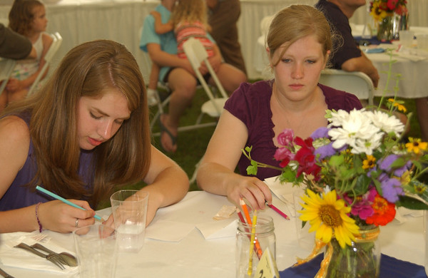 Trudy & Lydia, busy writing the letter