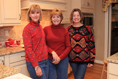 Sisters and friends in thier Christmas colors and jeans