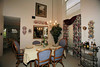 realtor pic of dining room - the ceiling is open to above - the doorway opening leads to the downstairs den and the kitchen