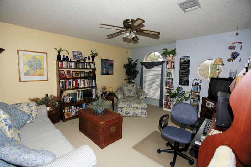 realtors pic of upstairs den -- the windows are on the front of the house -- the couch in the far left of this picture backs up to a half-wall which looks down into the dining room