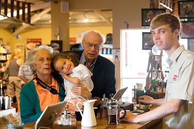 Carol Sierra and John sampling coffee at a specialty coffee bar