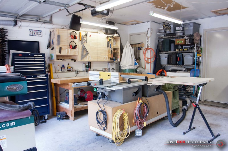 Wide view of my shop showing the flip-up folding outfeed table for my Ryobi BT3000 tablesaw made from an recycled hollow core door in the up position