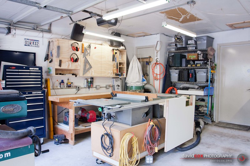 Wide view of my shop showing the flip-up folding outfeed table for my Ryobi BT3000 tablesaw made from an recycled hollow core door in the down position