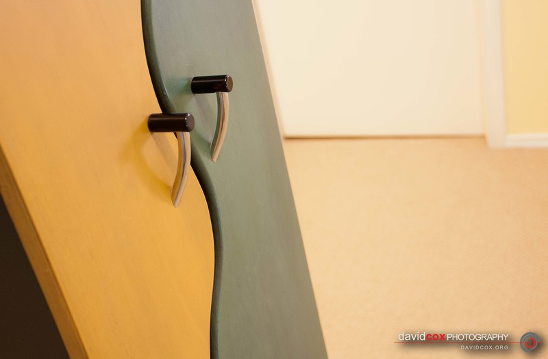 Closeup detail of door handles on Modern CD cabinet with curved doors