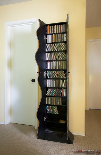 Open view of Modern CD cabinet with curved doors