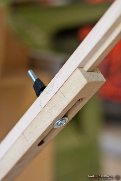 Close up detial of adjustable tongue & groove support arm which supports a Flip-up folding outfeed table for my Ryobi BT3000 tablesaw made from an recycled hollow core door