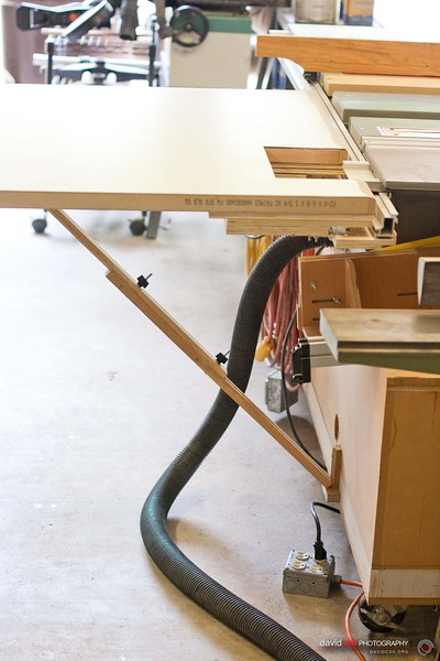 Wide shot of adjustable hypotenuse tongue & groove support arm which is anchored to the saw rather than the floor to support a Flip-up folding outfeed table for my Ryobi BT3000 tablesaw made from an recycled hollow core door