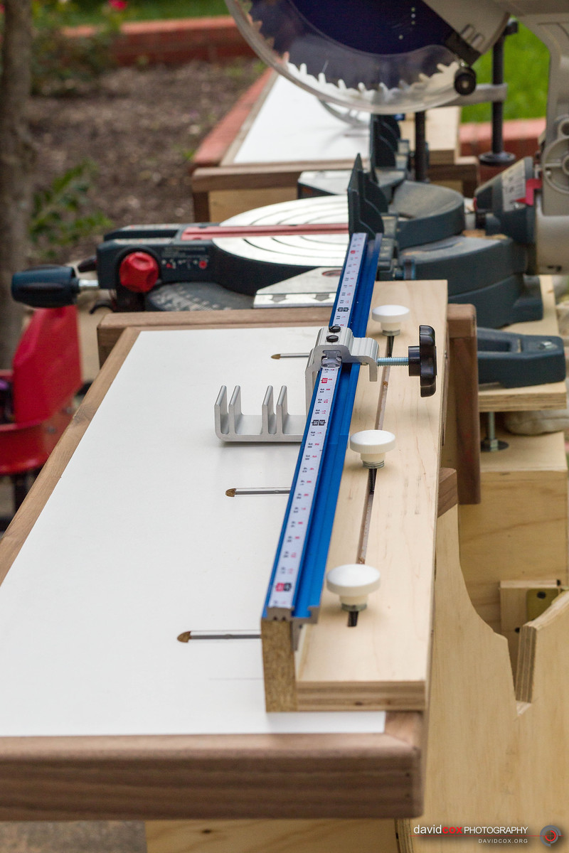 detail view of fence on rolling folding chop saw stand