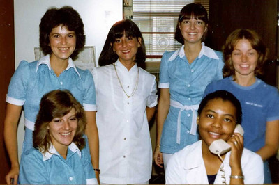 Front row sitting L to R : Louann Paul, assistant and Violet Payne, receptionist back row standing L to R: Janet Carmack, Renee ?, receptionist, Kathy Begnino, receptionist and Cathy Brown, RDH