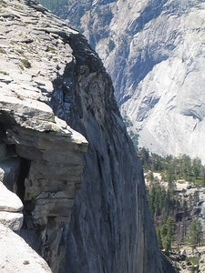 Tha face of Half Dome. There's a guy rock climbing up it, but he's so far away it's impossible to see him.