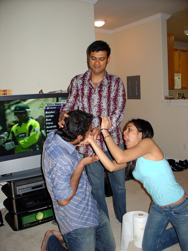 gopal and shivani display some sibling love by plastering the cake on my face :)
