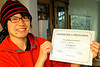 Fumito proudly (sort of) displays the certificate her received for telling a story in front of an entire Kaplan audience.