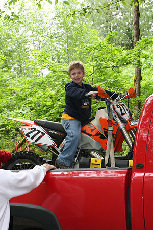 Jake and Tyler checking out the dirtbike - Memorial Day Weekend 2006