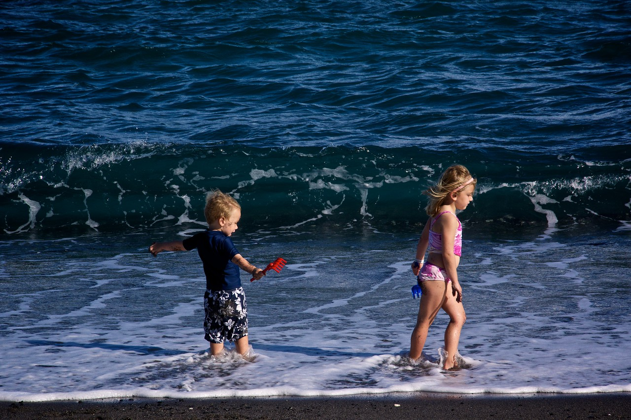 Luc and Claire at surf's edge  Honokapoe Bay